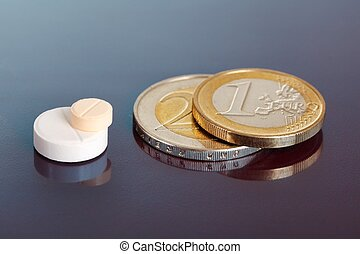 Stacked pills near pair of euro coins - Closeup on pair of...