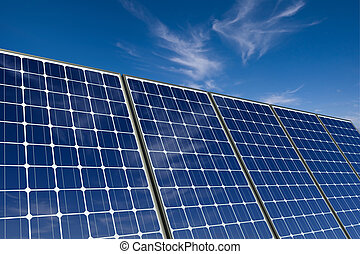 mono-crystalline solar panels against a blue sky