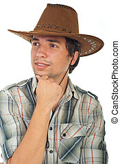 Smiling cowboy looking away and wearing brown hat isolated...