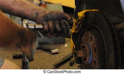 Worker repairs car