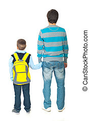 Father and son going to school - Back of father and son...