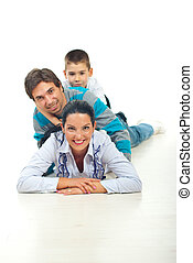 Happy family piled up in their house - Portrait of happy...