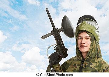 gun paintball player
