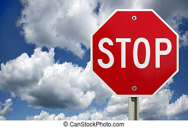 Stop sign, isolated - Stop sign against a dark cloudy sky...