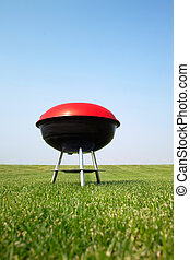 Barbeque grill on meadow