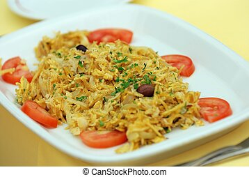 Traditional Portuguese codfish dish on a plate