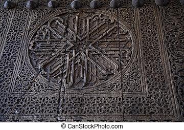 Uzbekistan, an ancient wooden door decorated