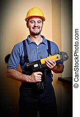 confident labor - portrait of standing manual worker holding...