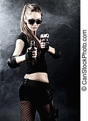 aim - Shot of a sexy military woman posing with guns.