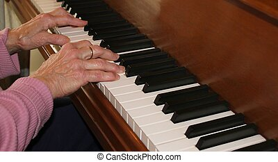 piano hands with experience - closeup of a senior citizens...