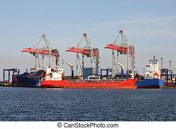 seaport with cranes and cargo ships