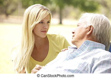 Senior Man Talking To Concerned Adult Daughter