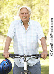 Senior Man On Cycle Ride In Park