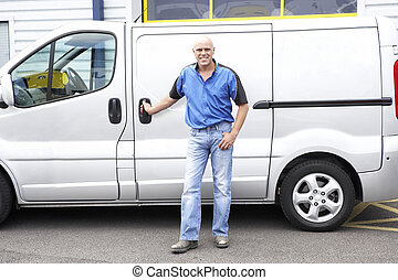 Man standing next to van