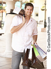 Young Man Enjoying Shopping Trip