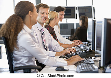 Stock Traders Working At Computers