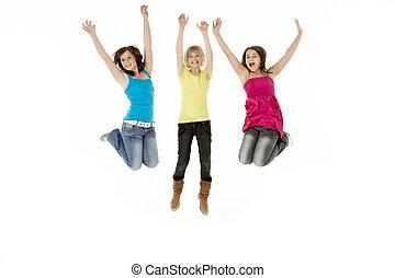 grupo, de, tres, joven, niñas, Saltar, en, Aire