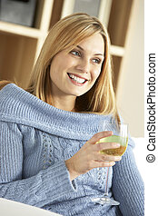 Young Woman Enjoying Glass Of Wine