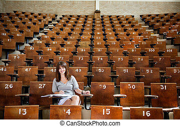 Young student at the university - Smiling young student in...