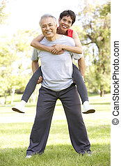 Senior Couple Working Out In Park