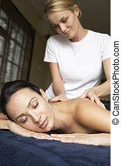 Young Woman Enjoying Massage