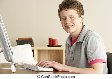Smiling Teenage Boy Studying at Home