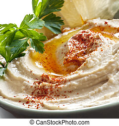 Hummus - Bowl of hummus topped with paprika. Traditional...
