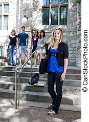 Students at college - College students on the stairs of...