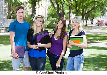 College students on campus - Group portrait of four college...