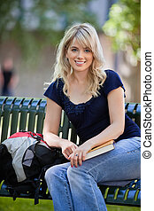 Female student sitting on bench