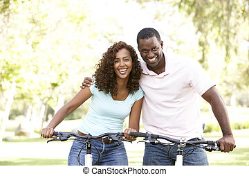 Couple On Cycle Ride in Park