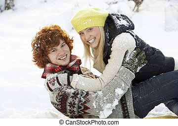 Romantic Teenage Couple Having Fun In Snow