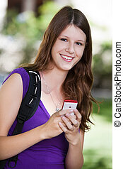 College girl holding cell phone - Portrait of young college...