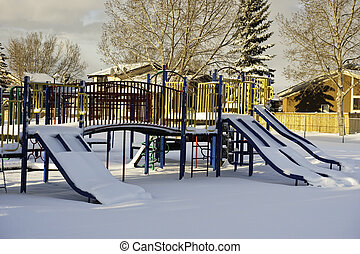 Too Cold to Play - Children's playground sits peacefully...
