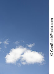 White Fluffy Cloud Against Blue Sky