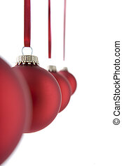 Line Of Red Christmas Decorations Hanging Against White...