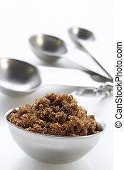 Brown Sugar In A Bowl With Measuring Spoons