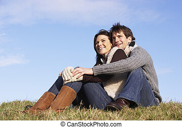 Couple Sitting In Park Together