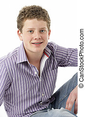 Studio Portrait of Smiling Teenage Boy