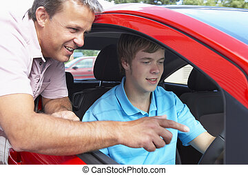 Teenage Boy Learning How To Drive