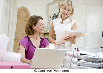 Women looking at paperwork together