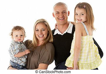 Studio Shot Of Family Group In Studio