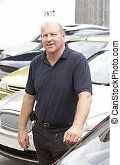 Car salesman standing on lot