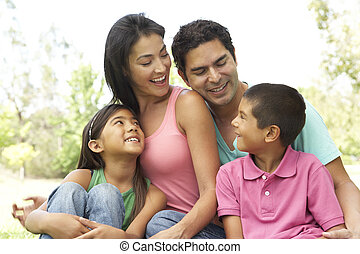 Portrait Of Young Family In Park