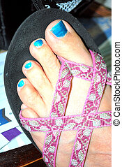 Painted toe nails.