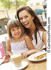 Mother And Daughter Enjoying Cup Of Coffee And Piece Of Cake...