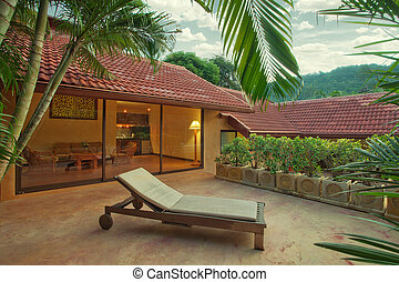 house - Panoramic view of nice tropic villa during sunset