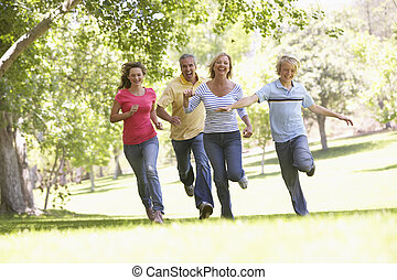 Family Running Through A Park