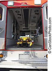 Interior of empty ambulance and gurney