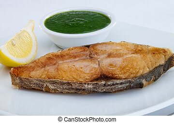 fish - close up view of nice fried fish with lemon on white...